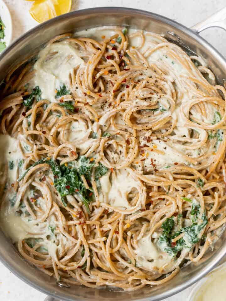 pot of pasta with cream sauce and lemon